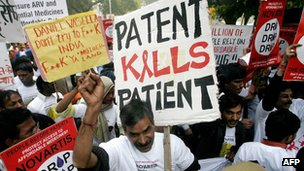 Protesters holding banners against medicine patents
