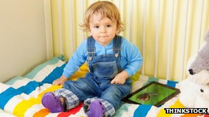 Toddler with an iPad