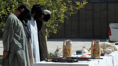 Taliban fighters stand blindfolded as they are presented to the media, after being captured by security forces, in Kandahar on March 5, 2012