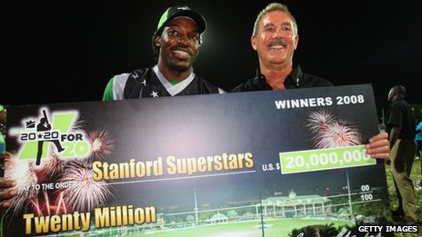 Cricketer Chris Gayle and Allen Stanford pose with a giant cheque during the Stanford Twenty20 Super Series in November 2008