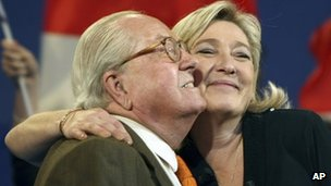 Marine Le Pen hugs her father Jean-Marie at a campaign meeting in Marseille, 5 March