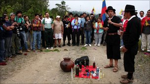 Indigenous Ecuadorian protesters take part in a ceremony at the start of the protest march
