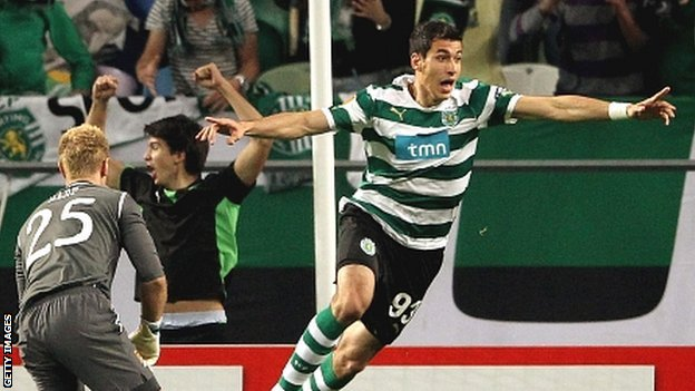 Xandao of Sporting Lisbon (right) celebrates after scoring