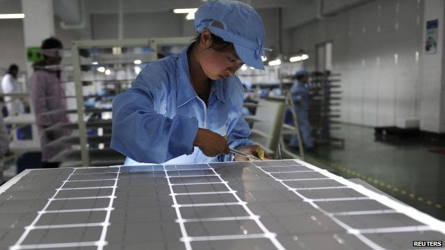 Employee working on a solar panel production line in Yongkang