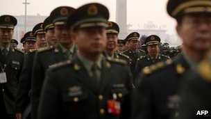 People's Liberation Army (PLA) soldiers arrive at the Great Hall of the People in Tiananmen square for the National People's Congress (NPC) in Beijing on 5 March, 2012