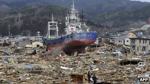 A fishing boat lies in debris in Kesennuma in Miyagi prefecture