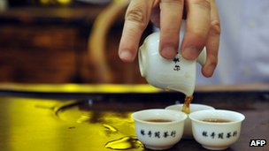 Tea being poured in a tea shop in Hong Kong