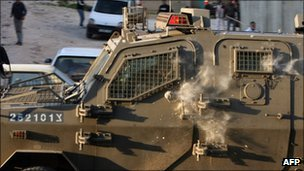 IDF armoured vehicle hit by stones in main street in Yatta