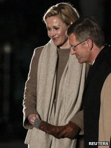German President Christian Wulff and his wife Bettina react after the Great Tattoo in Berlin, 8 March