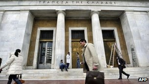 A man walks passed the Greek central bank