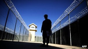 This file picture taken on November 15, 2009 shows a US captain silhouetted as he looks on during a media tour of Bagram prison, north of Kabul.