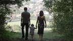 Family walking through trees