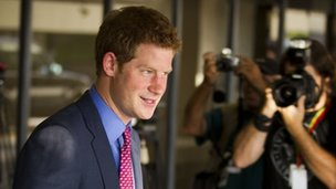 Prince Harry leaves the airport after arriving in Rio