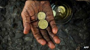 Beggar with coins, Manila