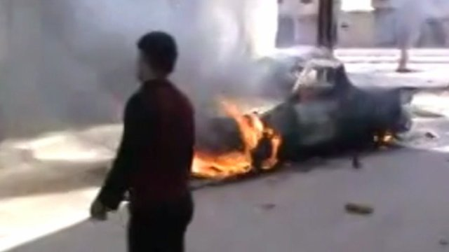 Burning car in Homs