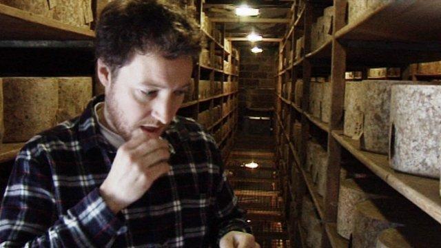 Cheesemaker Tom Calver tasting his cheddar