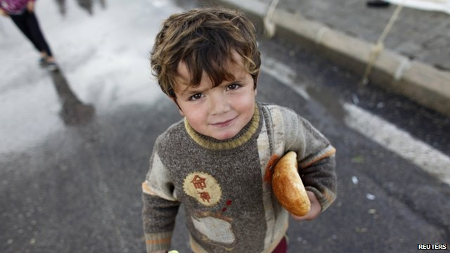 Boy refugee at camp on Turkish-Syrian border