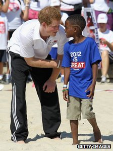 Prince Harry talks to young boy
