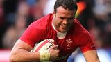 Jamie Roberts dives over to score for Wales
