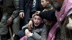 A boy mourns his father, Abdulaziz Abu Ahmed Khrer, who was killed by a Syrian Army sniper