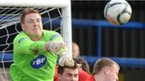Coleraine keeper Michael Doherty punches clear against Crusaders