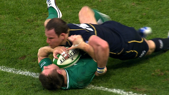 Tommy Bowe is tackled by Graeme Morrison
