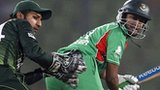 Bangladesh's Shakib Al Hasan bats, watched by Pakistan wicketkeeper Sarfraz Ahmed