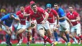 Wing George North launches a Wales atttack against Italy