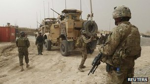 US and Afghan troops keep watch inside the base near Alkozai in Kandahar, Afghanistan, 11 March