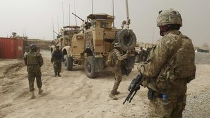 US and Afghan troops keep watch inside a base near Alkozai in Kandahar, Afghanistan, 11 March 