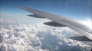 The view from above the clouds from the left side of an unidentified aeroplane