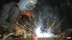 A worker at a factory in India