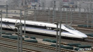 A China Railway High-speed (CRH) Harmony bullet train travels towards Beijing South Railway Station, 24 Feb 2012
