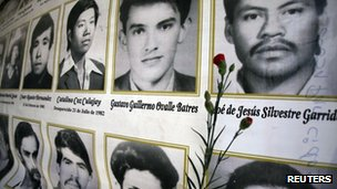 A red carnation is placed next to the photographs of people killed in Guatemala's 36-year civil war, before a ceremony to commemorate the National Day of Dignity in Guatemala City 25 February 2012.