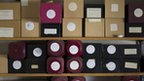 Labelled boxes of uncollected ashes in Bristol funeral director's office