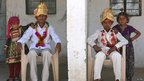 Boys wearing turbans sit next to their sisters before the boys' engagement ceremony begins at the village of Vadia in Gujarat state, India - 11 March 2012