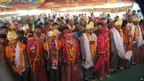 Newly married couples pose after a mass marriage in the village of Vadia, Gujarat state, India - 11 March 2012