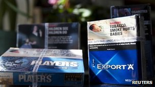 Photo illustration of cigarette packs sold in Canada