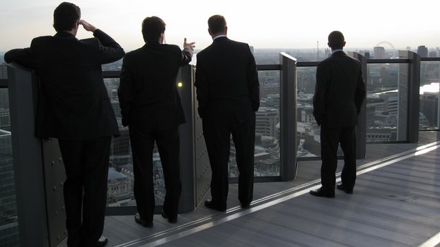 Four men on the terrace on the 23rd floor of the Willis Building (51 Lime Street) in the City of London.