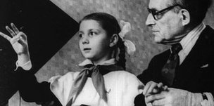 Leon Theremin teaching his grand-niece Lydia Kavina to play
