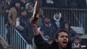 Man brandishing half burned Koran