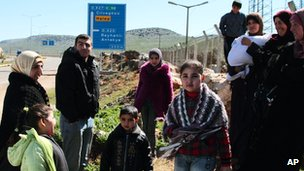 Syrian refugees outside their camp in Reyhanli, Turkey, on 4 March 2012