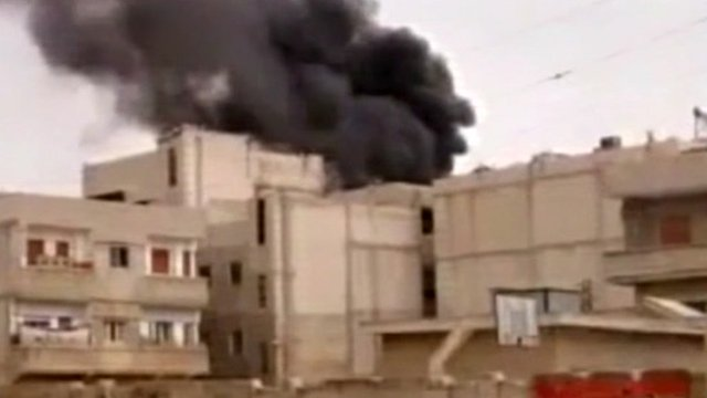 Burning building in Homs