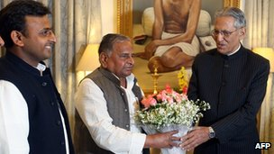 Akhilesh Yadav (left), Mulayam Singh Yadav (centre) and Uttar Pradesh Governor BL Joshi