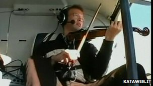 Playing a violin in a helicopter