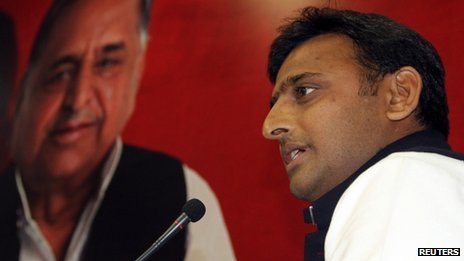 Akhilesh Yadav with a poster of father Mulayam Singh
