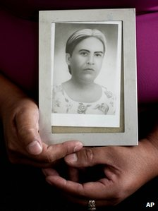 Felicita Romero holds an image of her mother Natividad Ramirez, a victim of the Dos Erres massacre