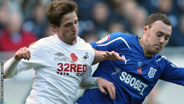 Swansea City&#039;s Joe Allen battles with Cardiff City&#039;s Darcy Blake