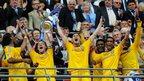 Chelsea hold the FA Cup aloft