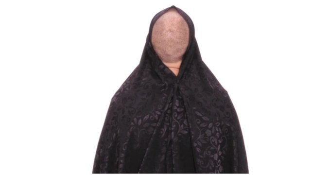 """A picture of a faceless model from Forouhar's """"Blind Spot"""" series."""